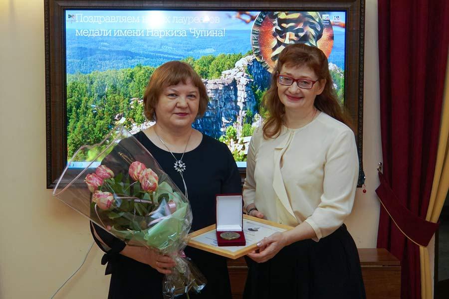 Вручение медали Наталье Паэгле